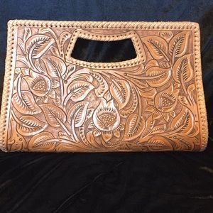 Leather made hand tooled clutch bag